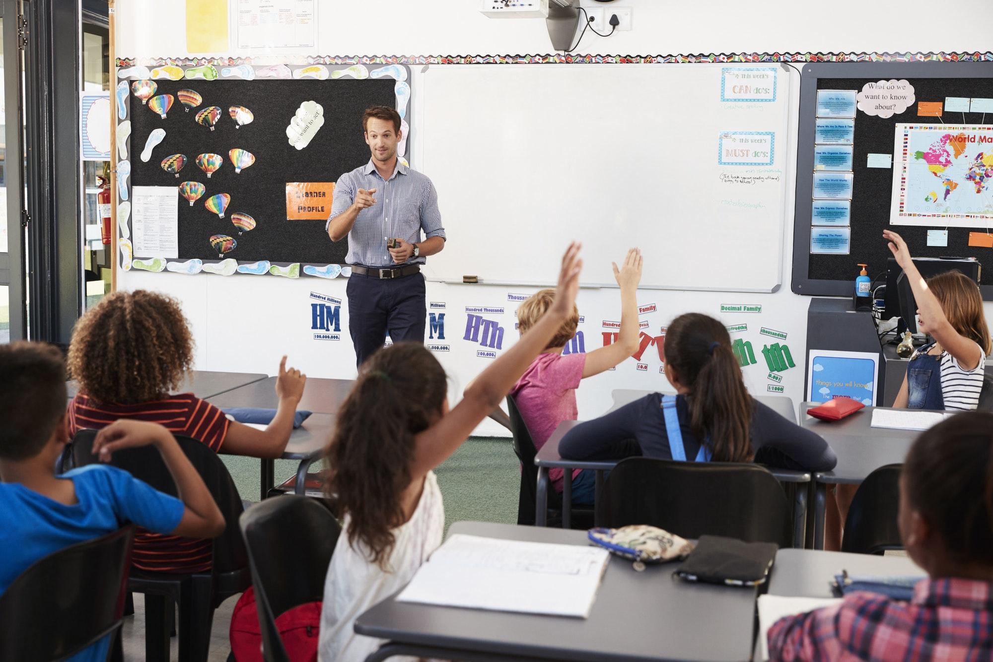 Teacher addressing pupils in an elementary school lesson