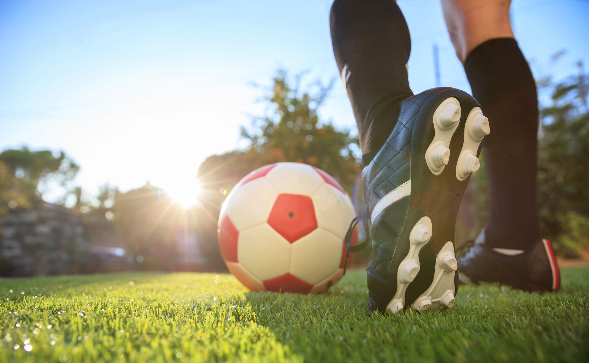 Woman and a soccer ball on the grass