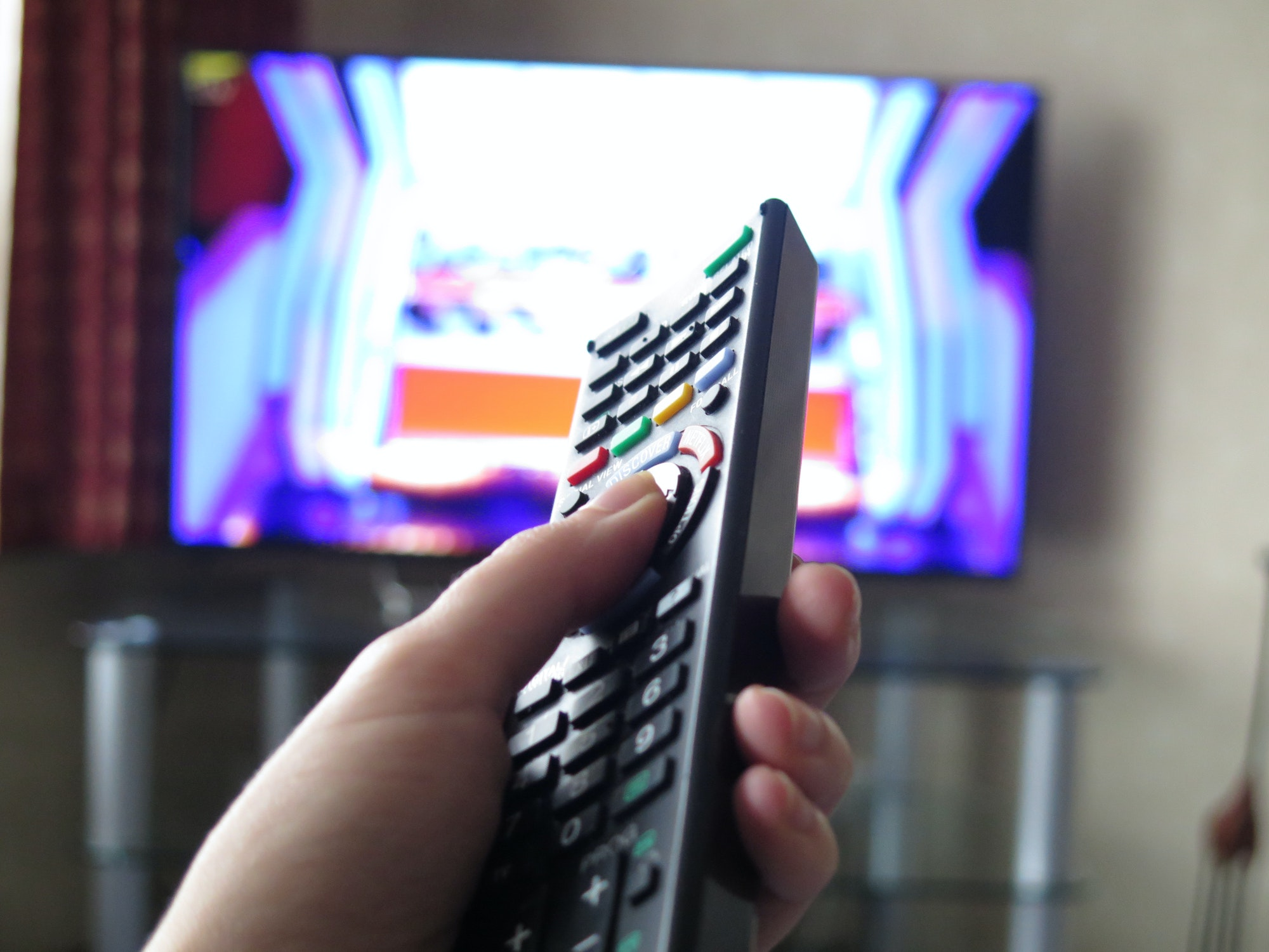 Remote control, watching television tv at home